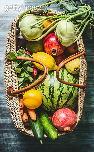 Various fruits and vegetables in rattan shopping bag , top view - gettyimageskorea