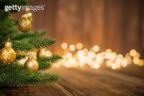 Fir Tree decorated with christmas balls on rustic wood and sparkles / defocused lights on the backgorund. Copy space for creative use. - gettyimageskorea