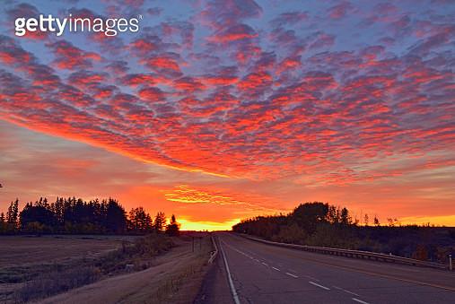 Sunrise skies over a prairie highway, Waskatenau, Alberta, Canada - gettyimageskorea