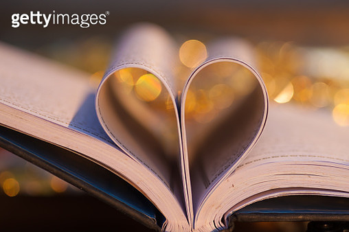 Heart design made of paper in book - gettyimageskorea
