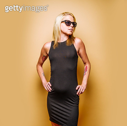 Woman in little black dress and sunglasses - gettyimageskorea