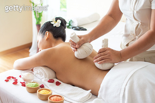 Herbal Massage in a spa - gettyimageskorea