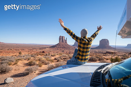 Young man with rental motor home enjoying road trip in USA - gettyimageskorea