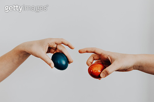 Cracking hard-boiled eggs as traditional game on Easter. Playful imitation of Michelangelo famous painting in the times of quarantine. - gettyimageskorea