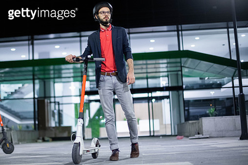 Business man driving his electric push scooter - gettyimageskorea