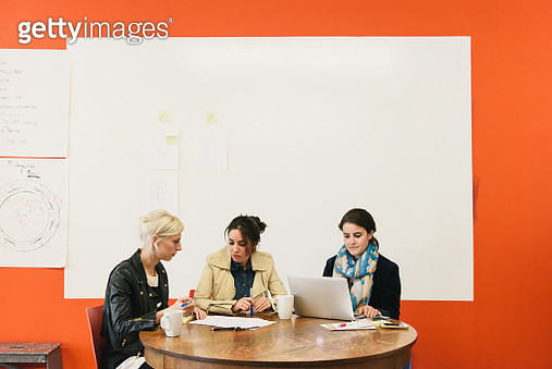 Women sitting at table with laptop having meeting - gettyimageskorea