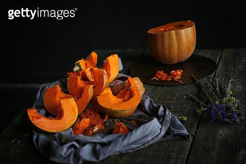 Pumpkin pieces on wooden table - gettyimageskorea