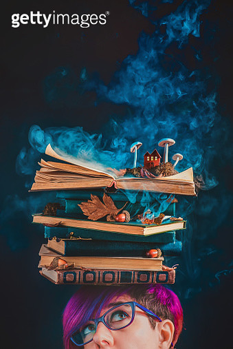 Stack of books on a head. Girl in glasses with magical books, open book with steam, mushrooms, and a tiny house with glowing windows - gettyimageskorea