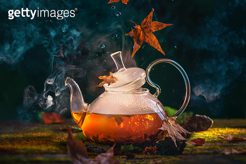 Natural tea, forest brew concept with glass teapot and falling autumn leaves. Magical food photography, seasonal drink header with copy space - gettyimageskorea