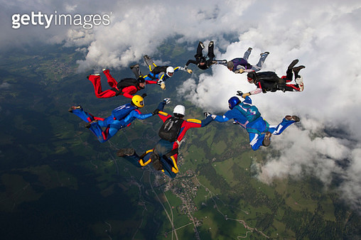Skydivers fall towards the earth - gettyimageskorea