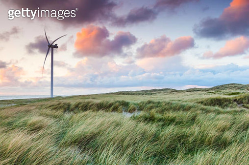Denmark, Jutland, Danish Riviera, Hvide Sande, Wind turbine at dusk - gettyimageskorea