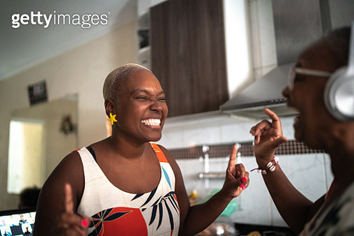 Mother and daughter dancing at home - gettyimageskorea