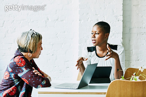 Female financial advisor in discussion with client in office conference room - gettyimageskorea