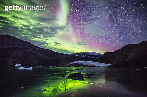 The bright colors of the aurora borealis in Scoresby Sound of East Greenland - gettyimageskorea