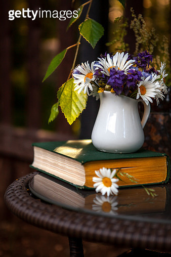 Old books, a bouquet of wildflowers in a cozy corner - gettyimageskorea