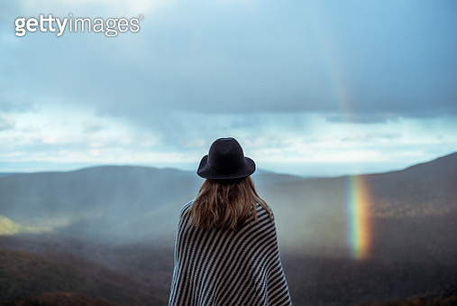 Young woman hiking through beautiful mountains. - gettyimageskorea