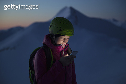 Woman smsing in the Austrian Alps - gettyimageskorea