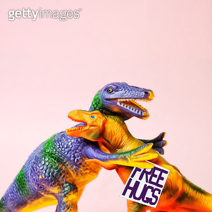 Digital painting of two plastic dinosaurs hugging each other. - gettyimageskorea