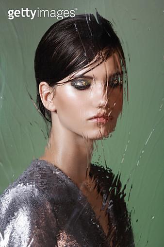 Beautiful woman behind wet glass - gettyimageskorea