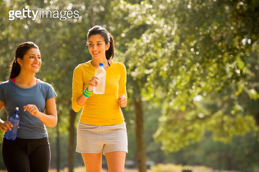 Hispanic women walking in park - gettyimageskorea