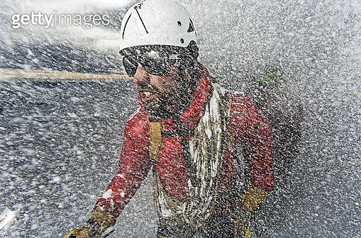 Male mountain climber in a snow storm in the Austrian Alps - gettyimageskorea