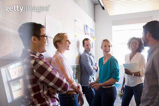 Business people laughing in meeting - gettyimageskorea