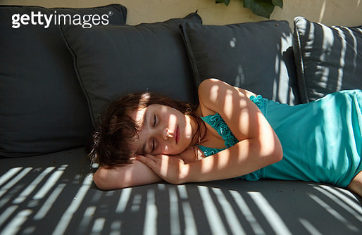 Close-up of child having fun outside on a warm summers day sleeping - gettyimageskorea