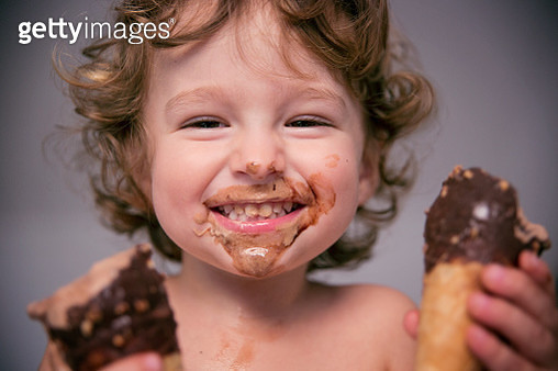 Happy toddler with two icecreams - gettyimageskorea