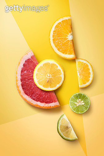 Flat lay assorted citrus fruits on graphical design background. Decorative design background. - gettyimageskorea