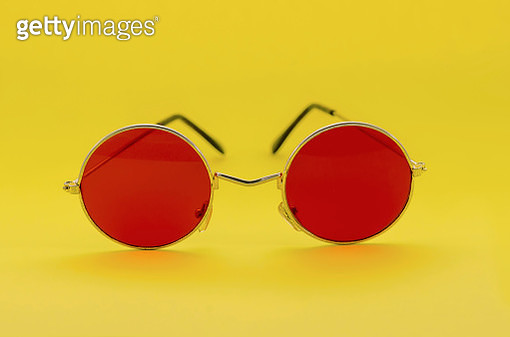 Close-Up Of Red Sunglasses Over Yellow Background - gettyimageskorea