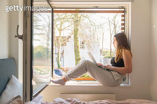 Teenage girl using laptop - gettyimageskorea