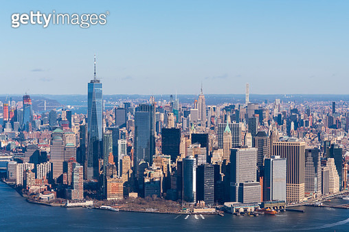 Helicopter aerial view of Manhattan island and harbor - gettyimageskorea