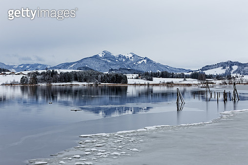 Scenic View Of Lake By Snowcapped Mountains Against Sky - gettyimageskorea