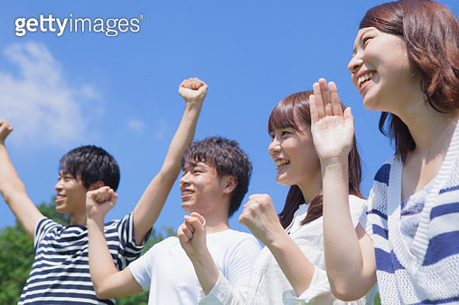 Young japanese people who smile in the park - gettyimageskorea