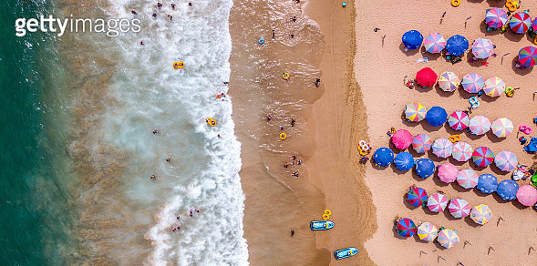 Aerial view of beach with visitors and umbrellas, Taiwan - gettyimageskorea