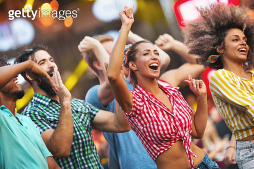 Friends dancing at a concert. - gettyimageskorea