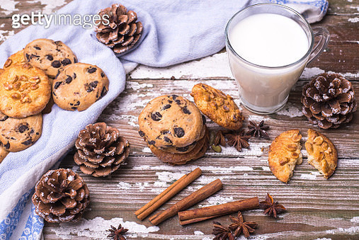Treats For Santa Claus Freshly Baked Natural Biscuits With Cup Of Milk On A Wooden Background. - gettyimageskorea