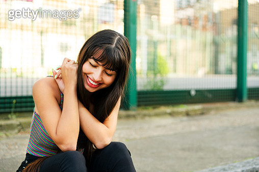 Happy woman looking down - gettyimageskorea