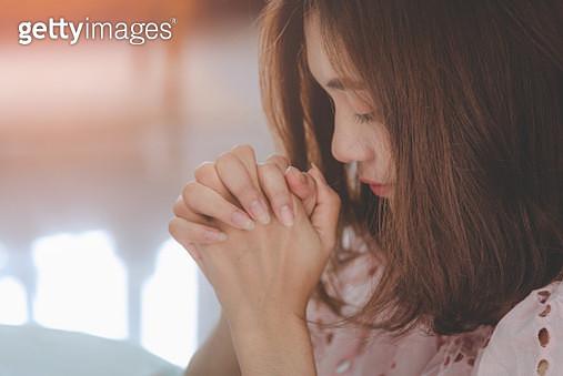 Woman Praying At Home - gettyimageskorea