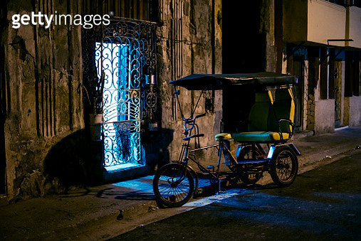 illuminated entrance with empty parking biketaxi at night in havana, cuba, march 16, 2018 - gettyimageskorea