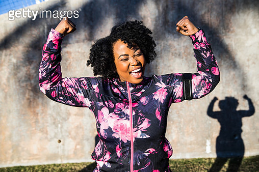 Funny portrait of a young black curvy woman during a training session - gettyimageskorea