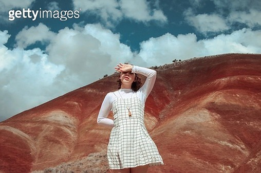 Low Angle View Of Young Woman Standing Against Sky - gettyimageskorea