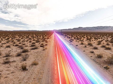 Clean energy cars moving fast with colorful lights moving fast in the straight road of the California desert. - gettyimageskorea