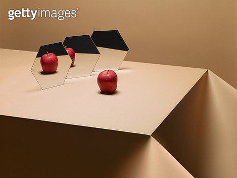 One Apple on table with mirrors - gettyimageskorea