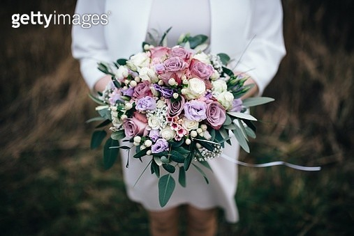 Midsection Of Woman Holding Bouquet Of Flowers - gettyimageskorea