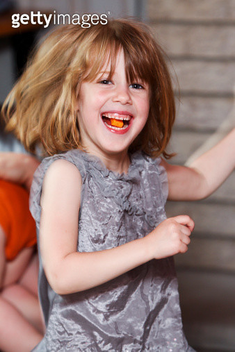 Young girl with candy in her mouth - gettyimageskorea