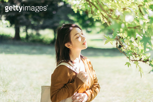 Young Woman Relaxing In Nature With Eye Closed - gettyimageskorea