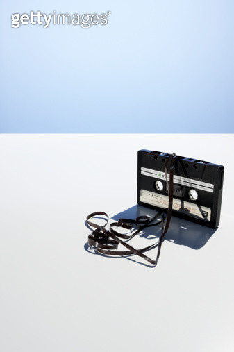 Cassette with tangled recording tape on table - gettyimageskorea