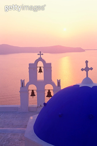 Church in sunset, Caldera in background, Santorini - gettyimageskorea
