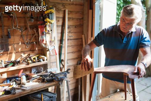 Man sanding wood in workshop - gettyimageskorea